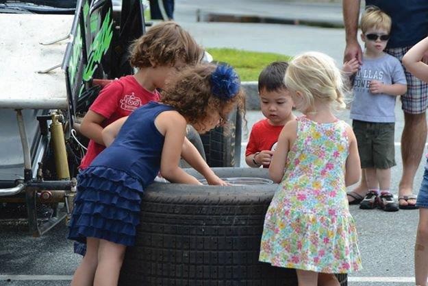 kids checking out a tire